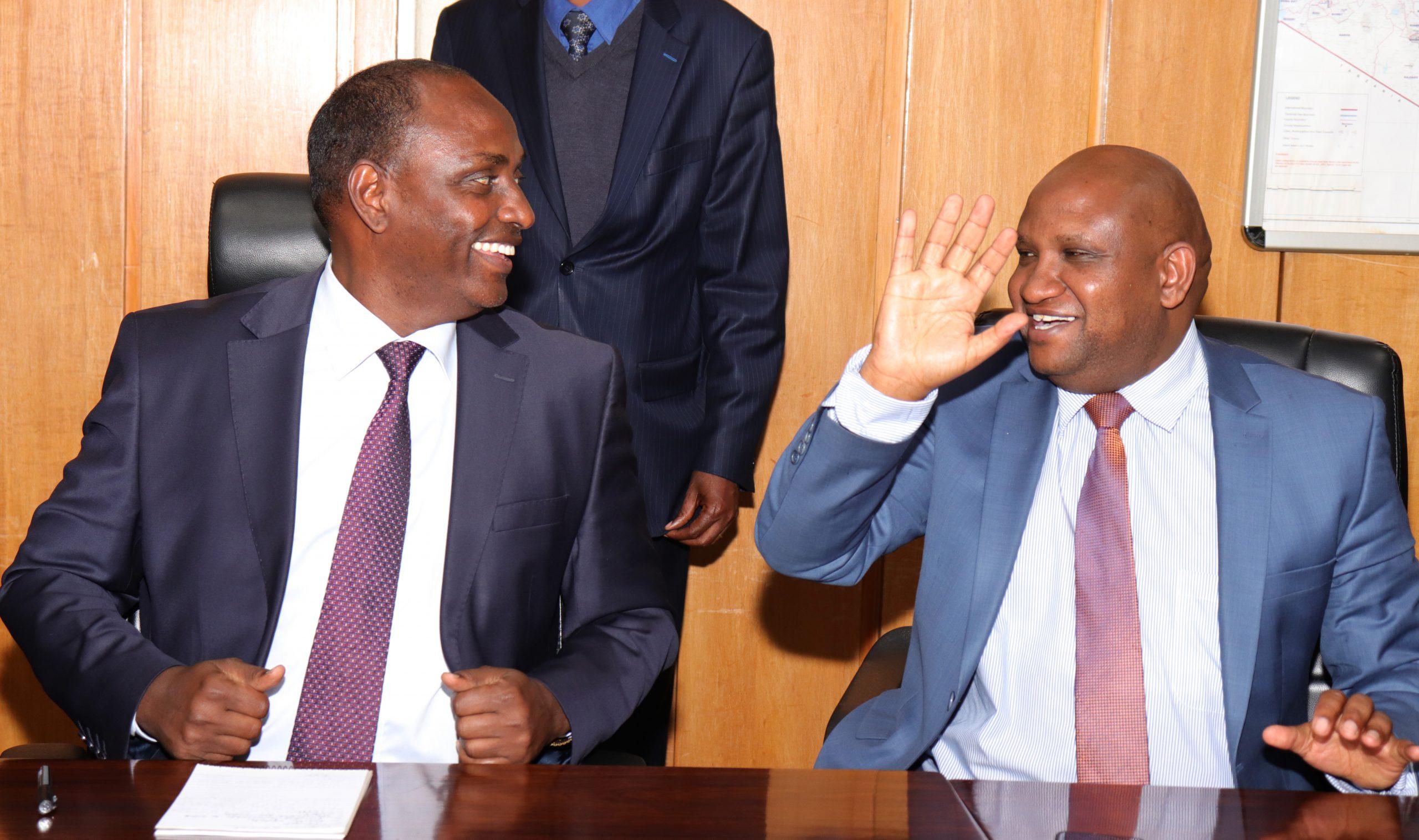 Acting National Treasury CS Ukur Yattani with KRA Commissioner General Githii Mburu at Treasury Buildings